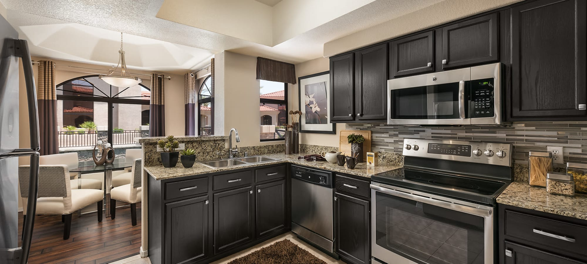 Spacious kitchen with granite counter tops at San Lagos in Glendale, Arizona
