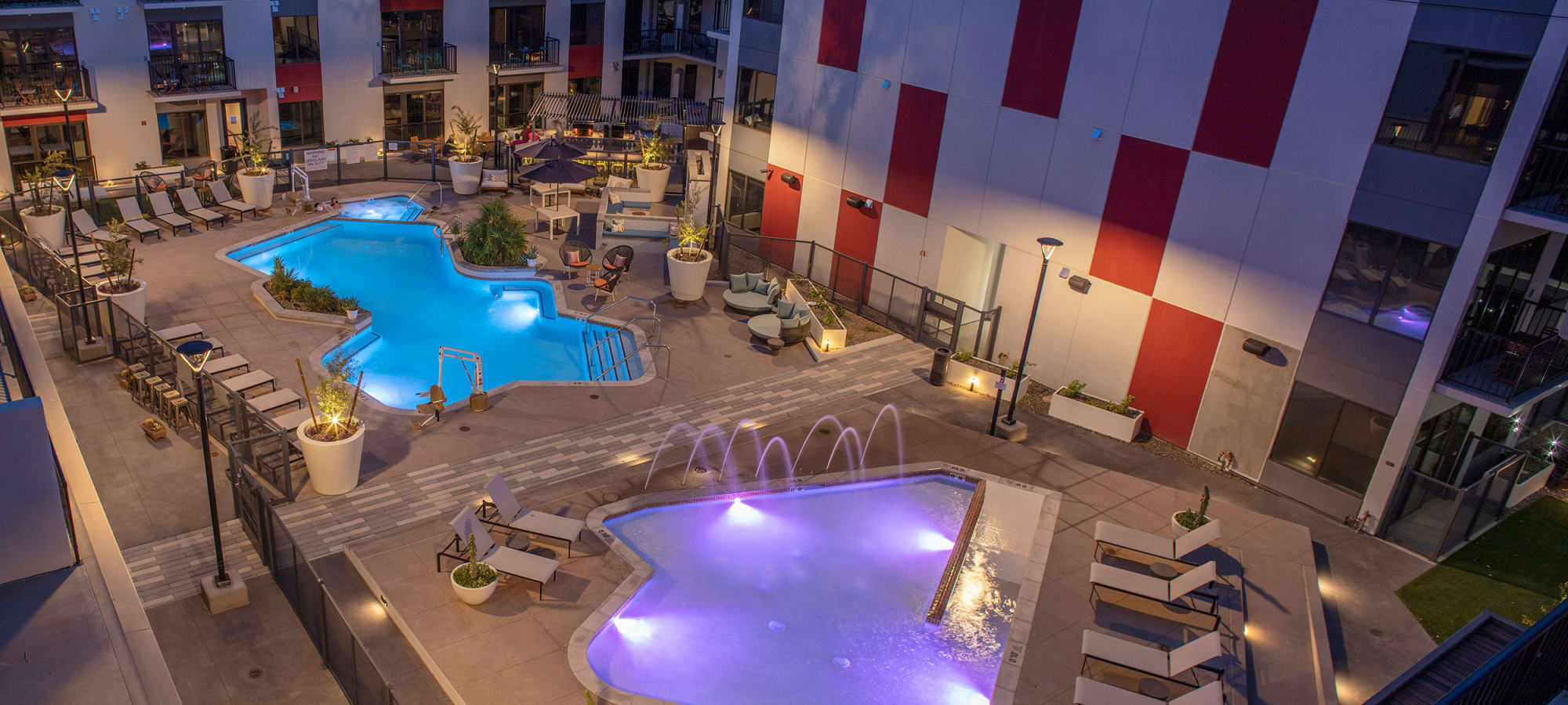 Pool at nighttime at The Local Apartments in Tempe, Arizona