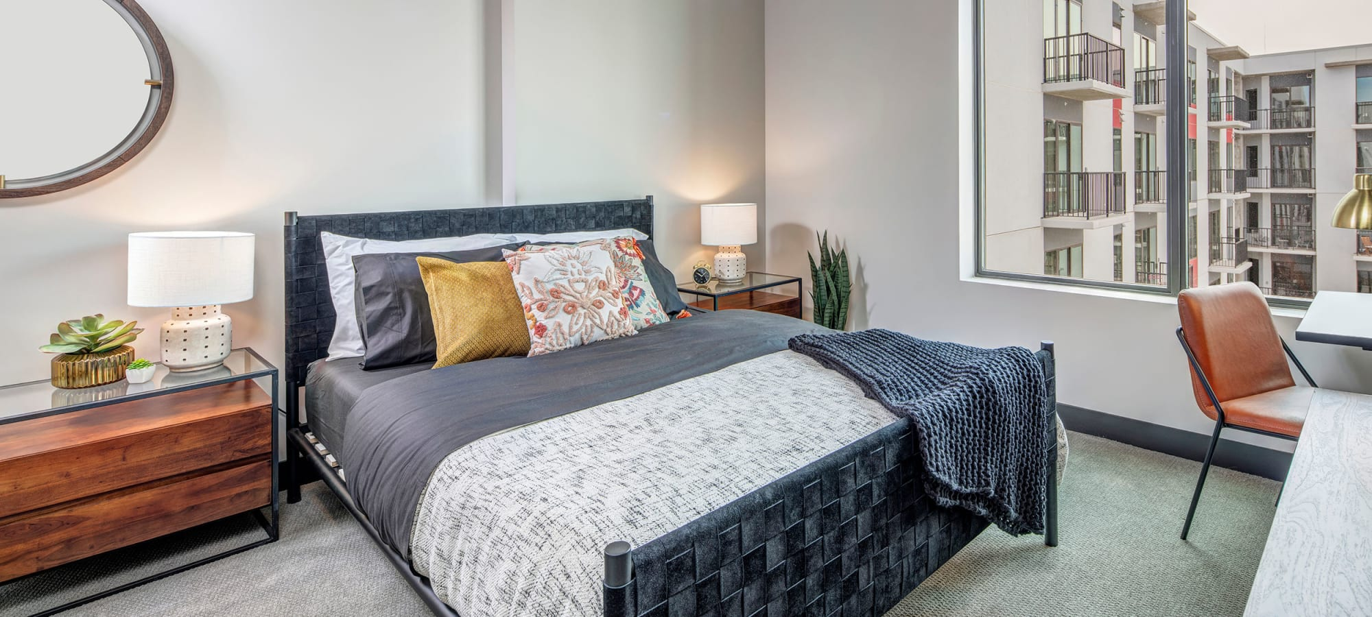 Spacious bedroom with decor at The Local Apartments in Tempe, Arizona