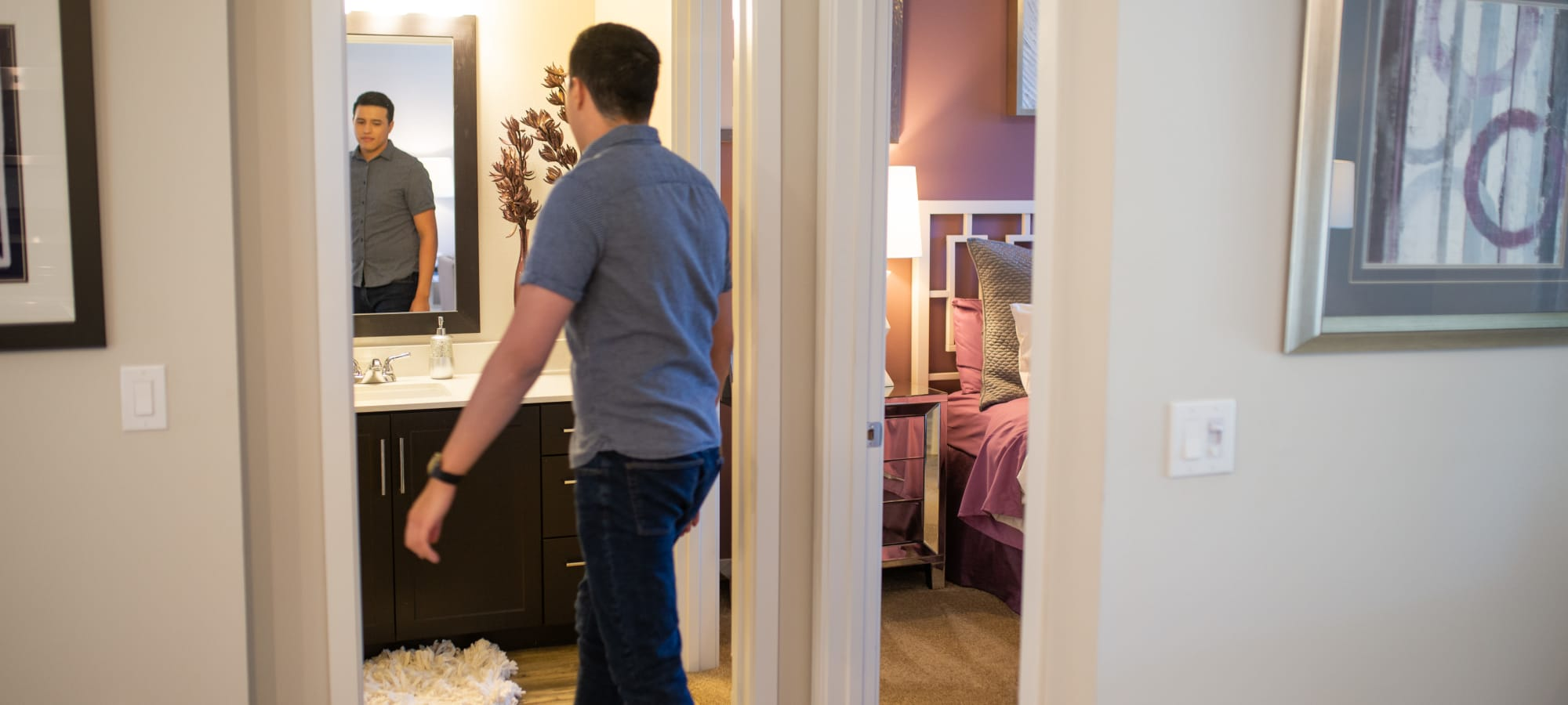 Resident enjoying their bathroom with a large vanity mirror at BB Living at Val Vista in Gilbert, Arizona