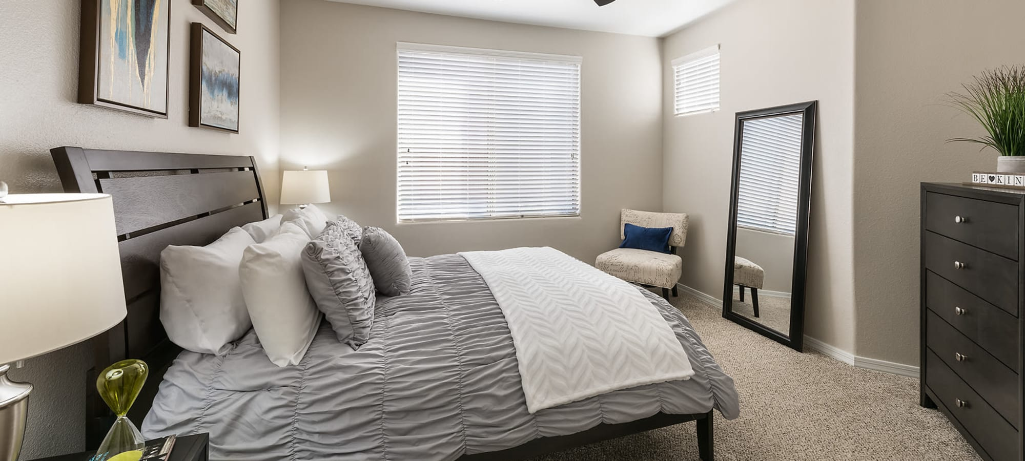 Spacious bedroom with ceiling fan at Laguna at Arrowhead Ranch in Glendale, Arizona