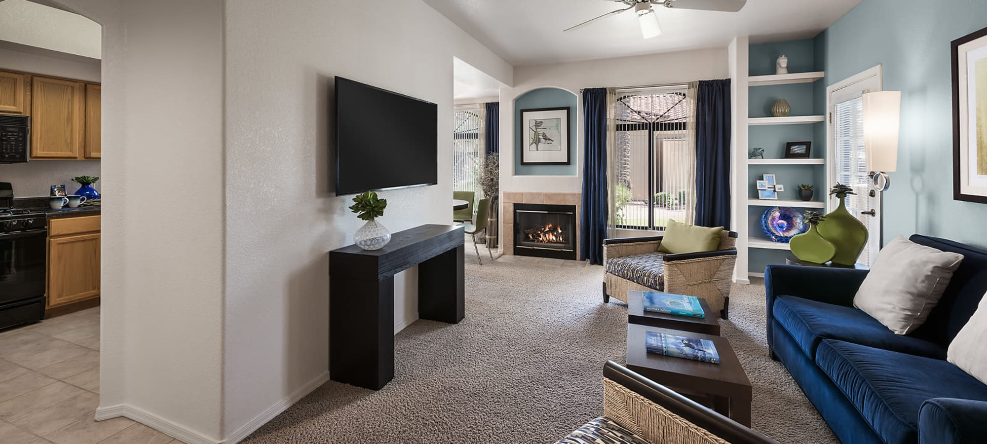 Open floorplan living room with fireplace in a model home at San Pedregal in Phoenix, Arizona