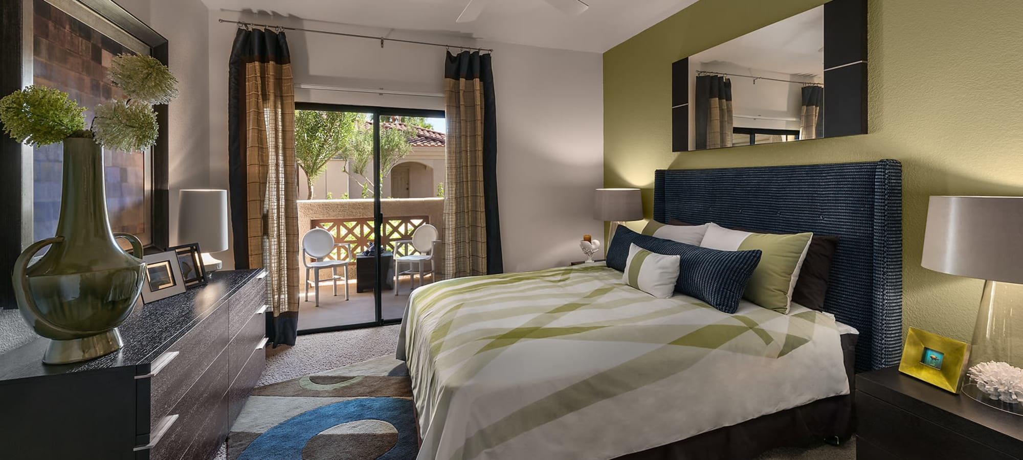 Master bedroom with patio access in a model home at San Pedregal in Phoenix, Arizona