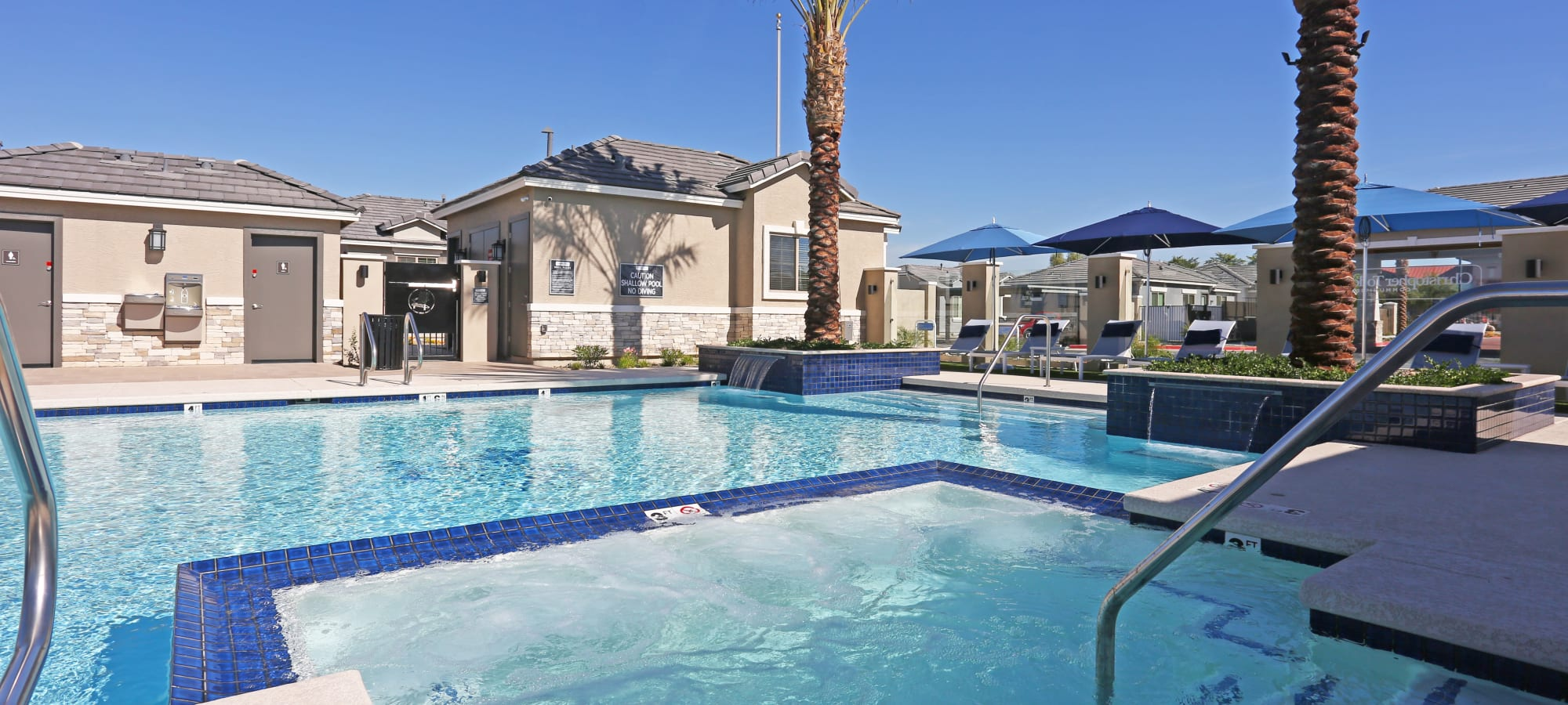 Pool and adjacent spa at Christopher Todd Communities At Estrella Commons in Goodyear, Arizona