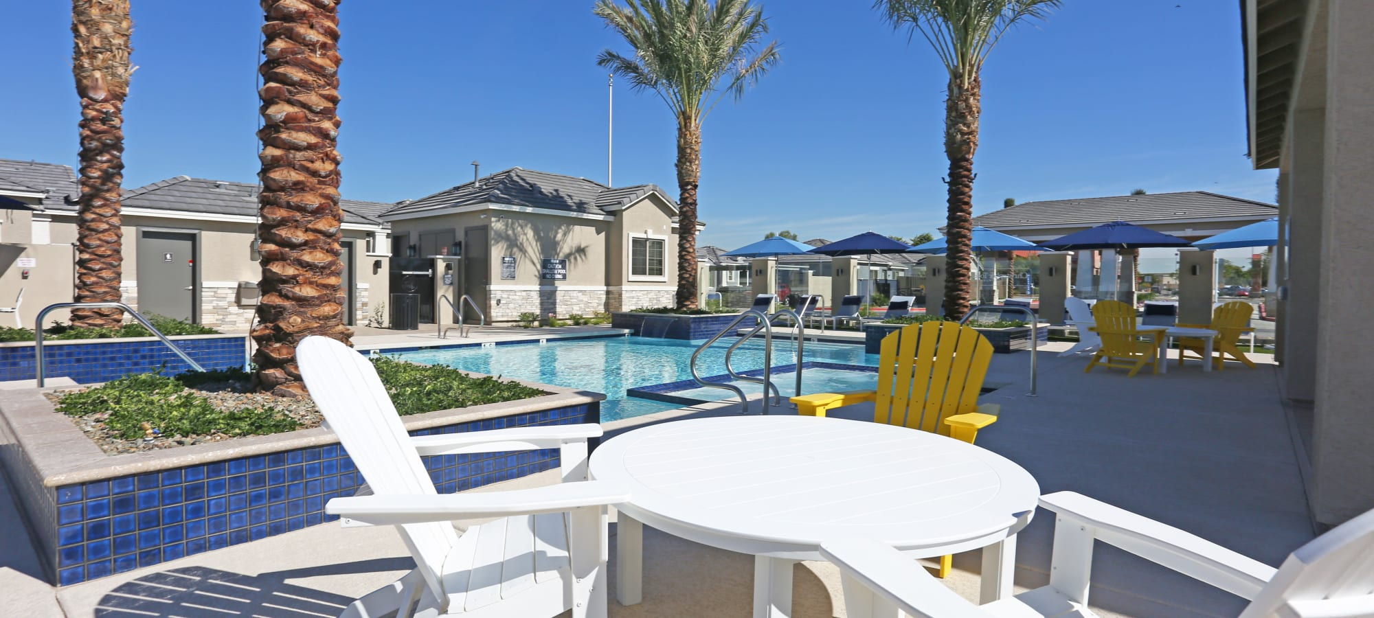 Comfortable seating near the pool at Christopher Todd Communities At Estrella Commons in Goodyear, Arizona