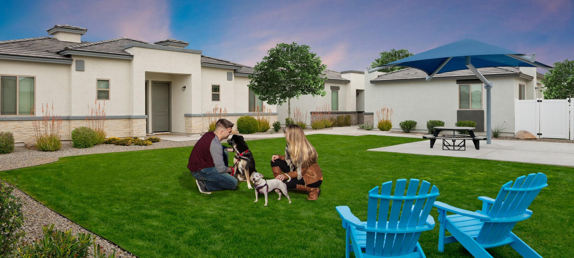 Residents and their pup enjoying the bark park at Christopher Todd Communities At Estrella Commons in Goodyear, Arizona