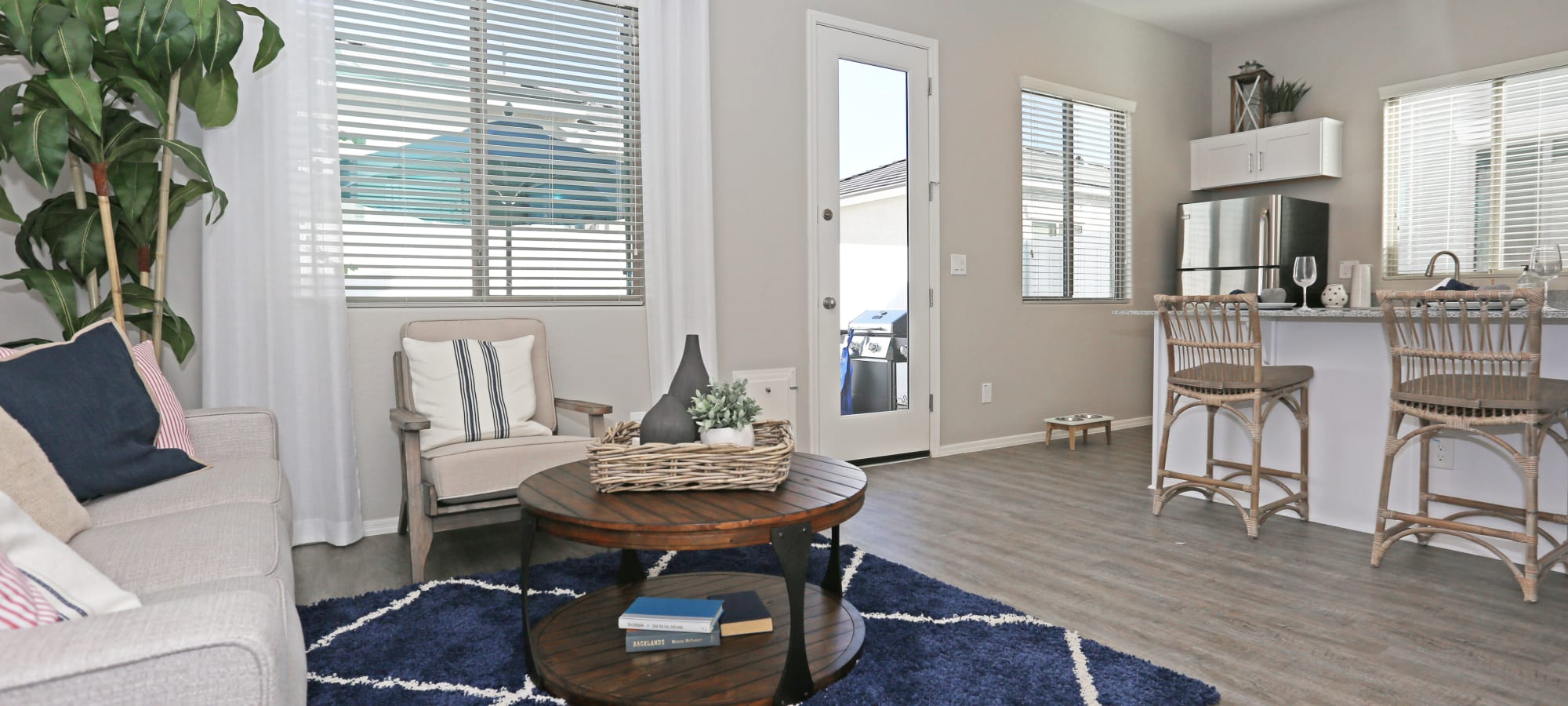 Comfortable living room in a model home at Christopher Todd Communities At Estrella Commons in Goodyear, Arizona