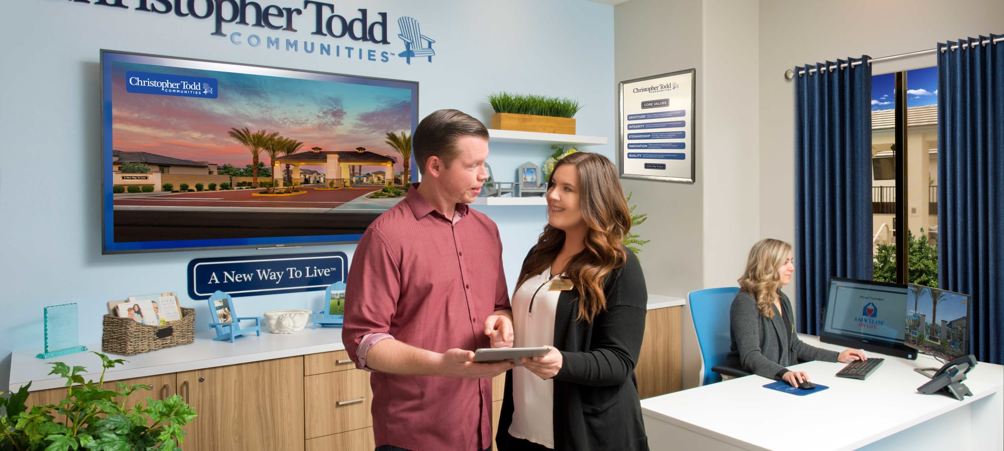 Future resident talking with the friendly staff in the leasing office at Christopher Todd Communities At Estrella Commons in Goodyear, Arizona