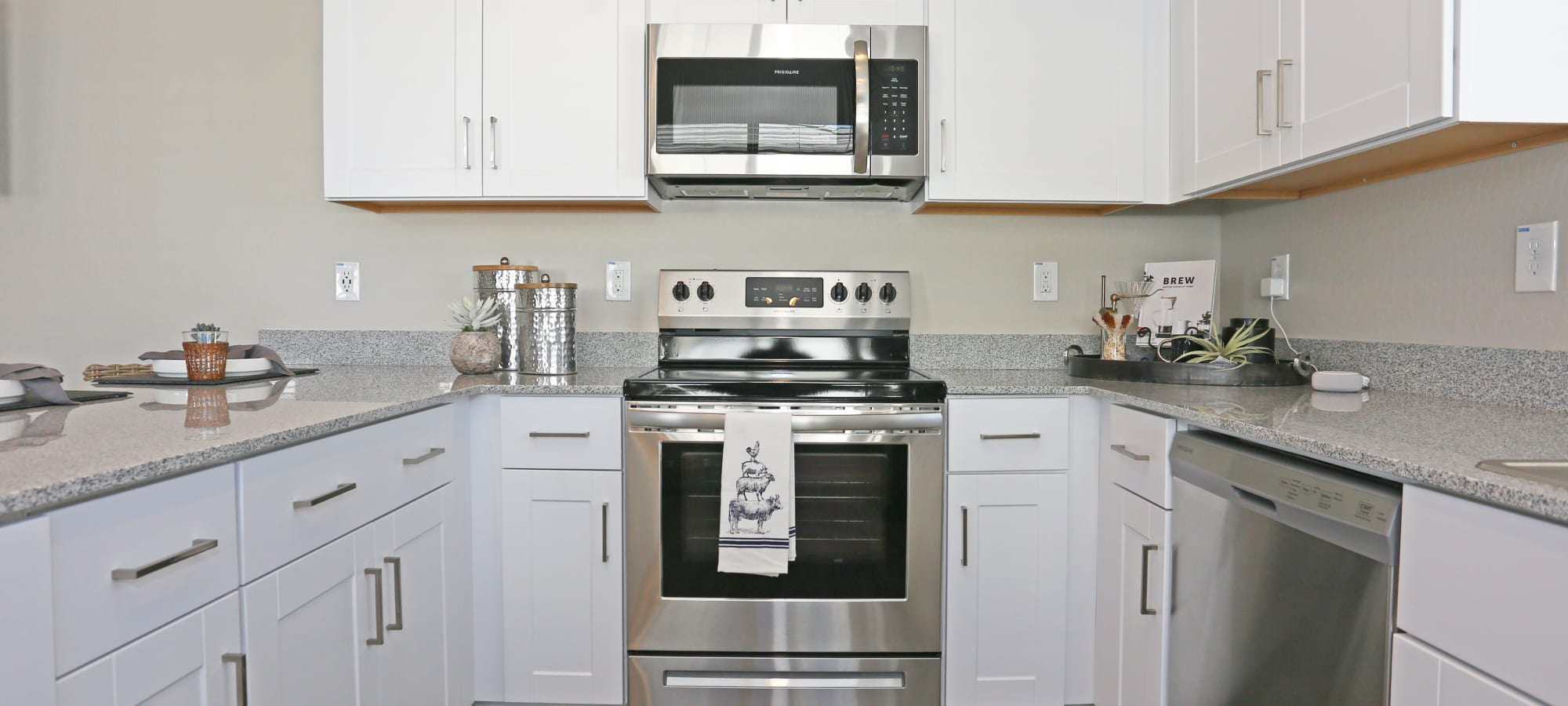 Stainless-steel appliances in a model home's kitchen at Christopher Todd Communities At Estrella Commons in Goodyear, Arizona