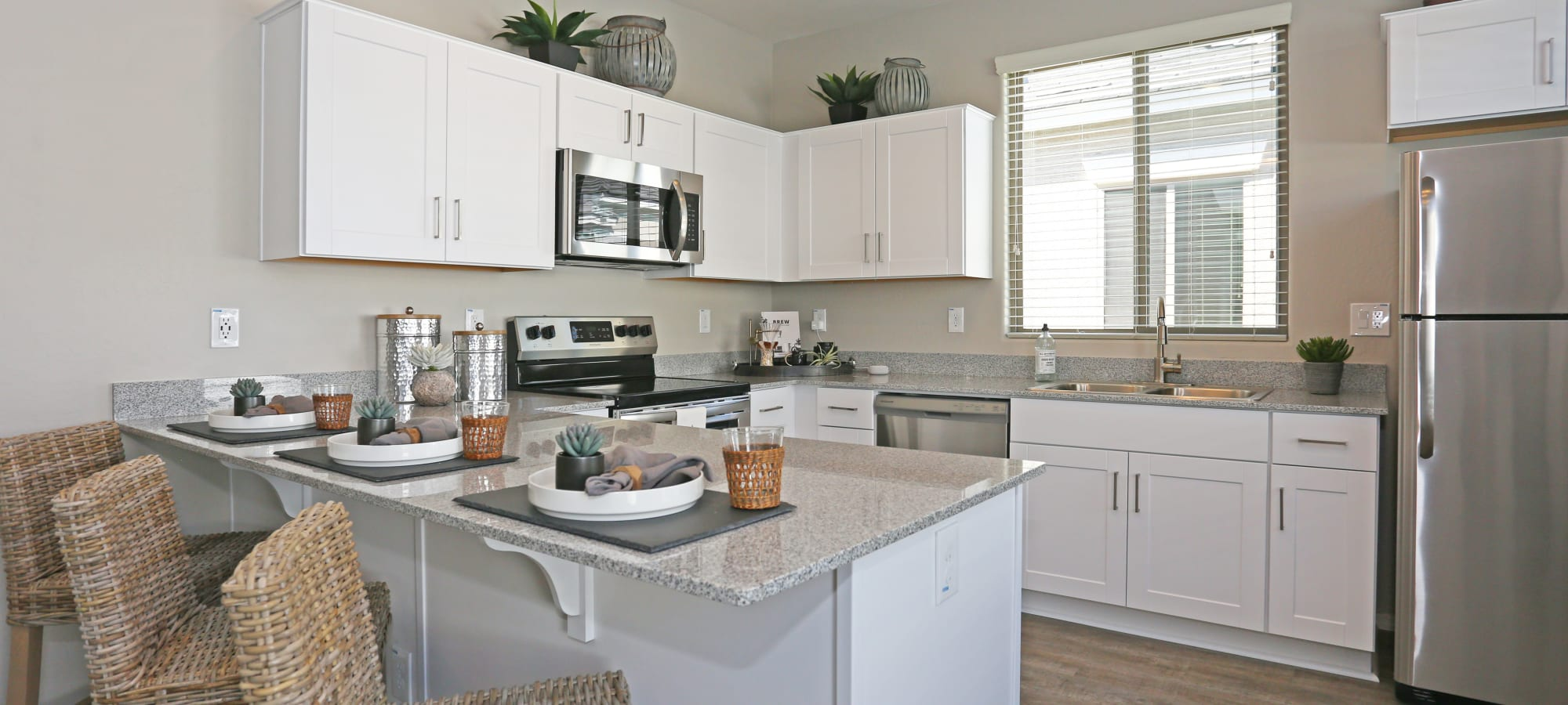 Granite countertops in a model home's kitchen at Christopher Todd Communities At Estrella Commons in Goodyear, Arizona