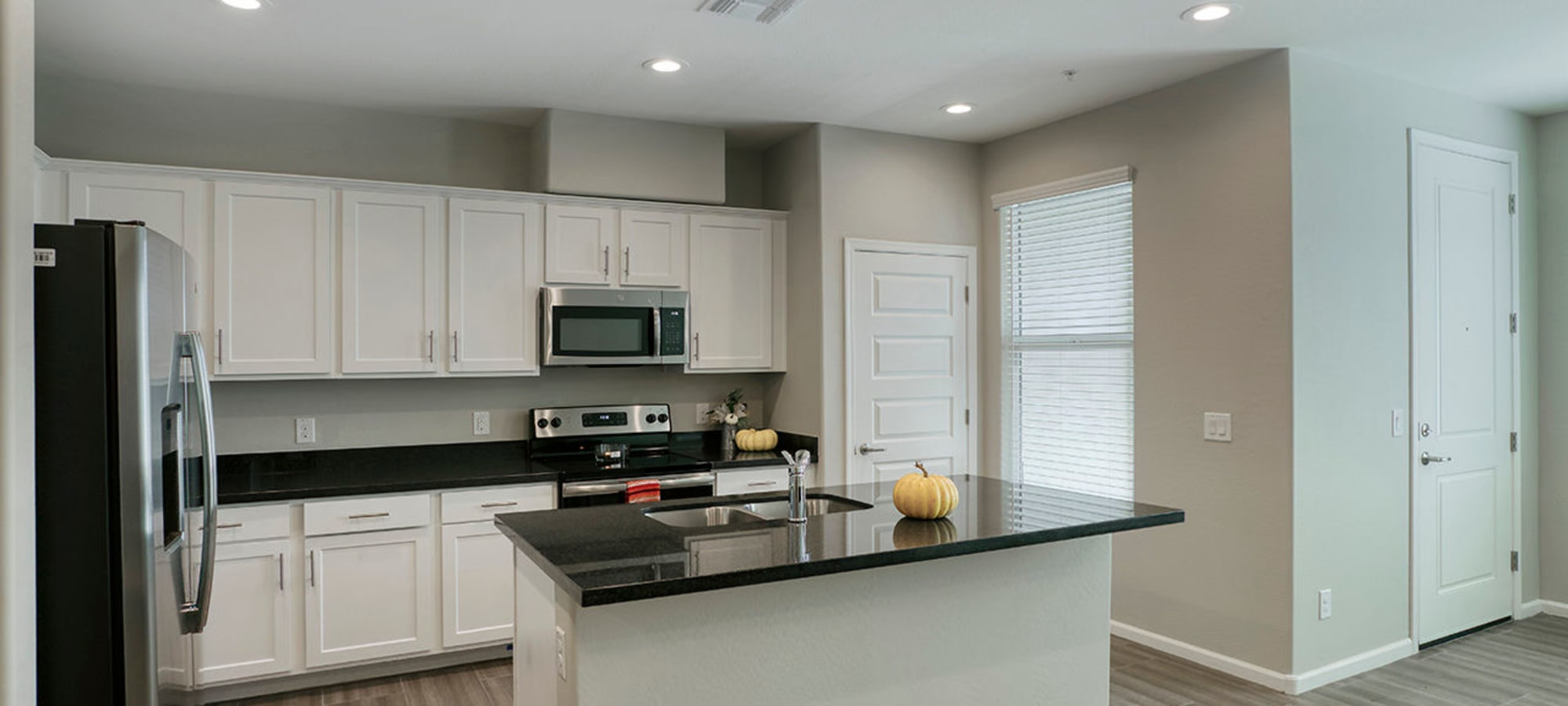Luxury kitchen with white cabinets at BB Living at Eastmark in Mesa, Arizona