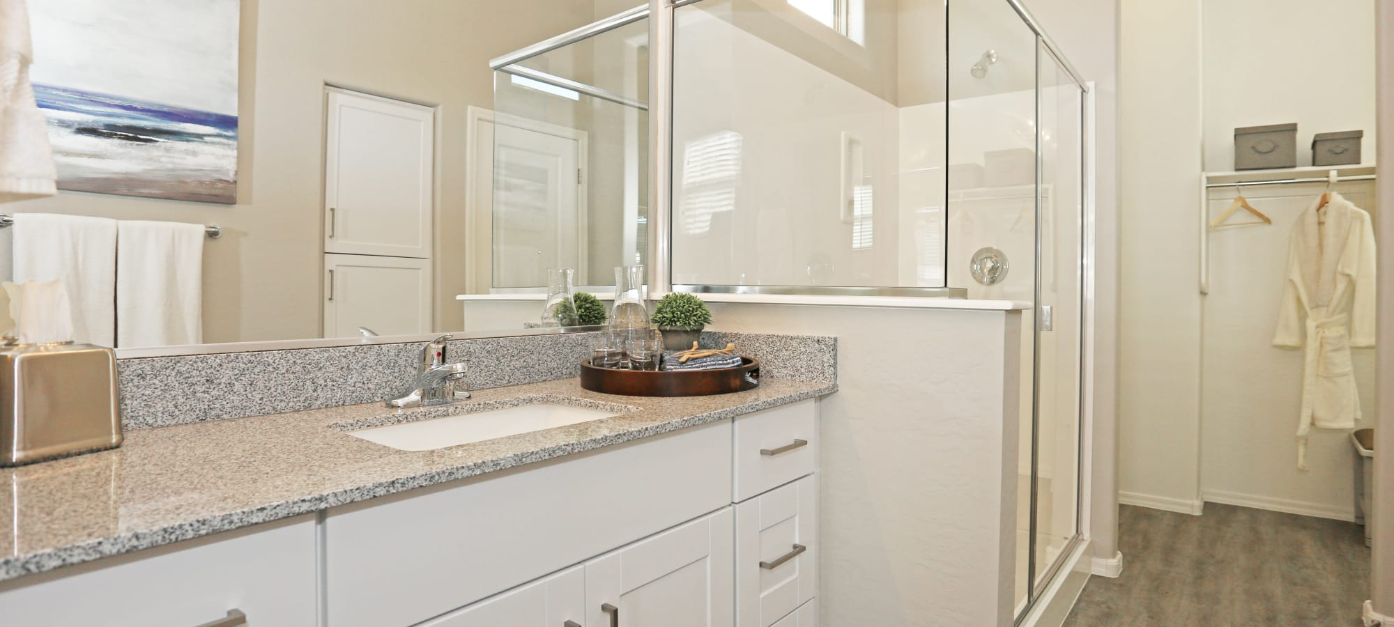 Granite countertop in the bathroom of a model home at Christopher Todd Communities On Happy Valley in Peoria, Arizona