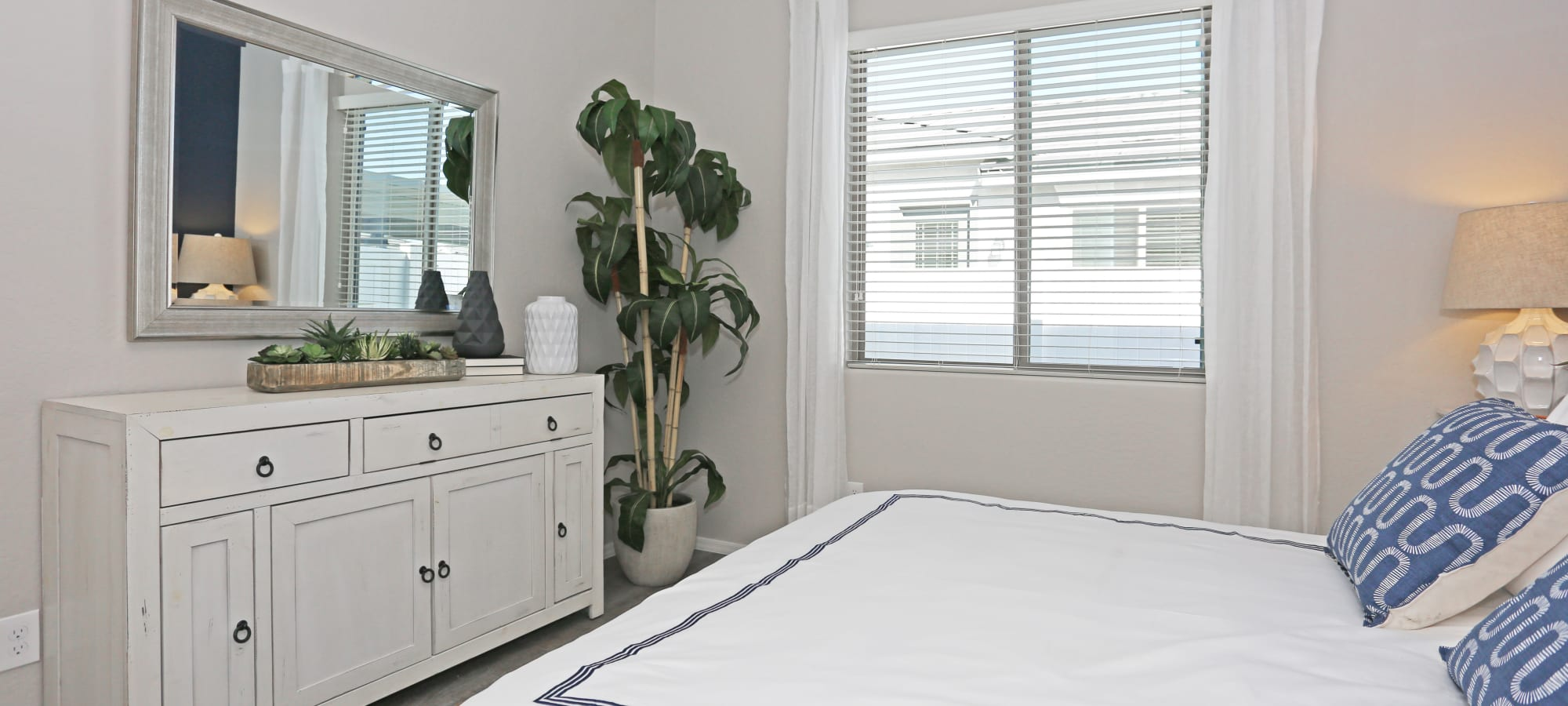 Well-decorated bedroom in a model home at Christopher Todd Communities On Happy Valley in Peoria, Arizona