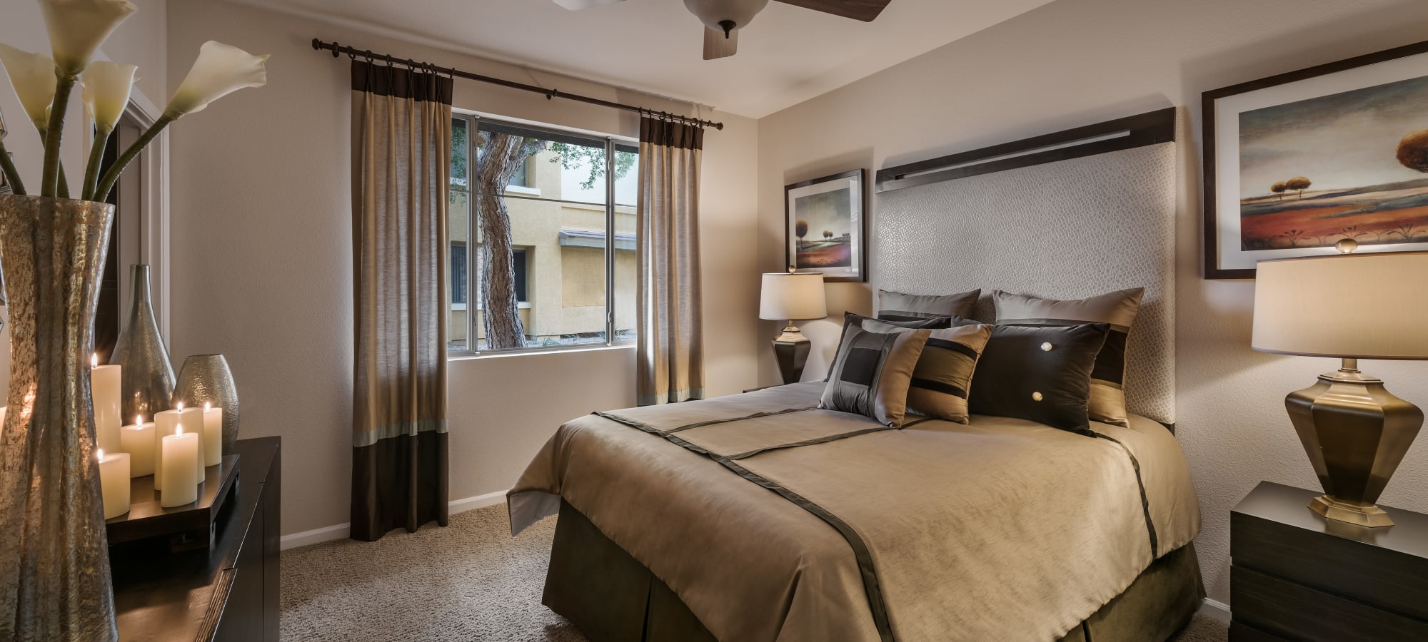 Master bedroom with a large window at Borrego at Spectrum in Gilbert, Arizona