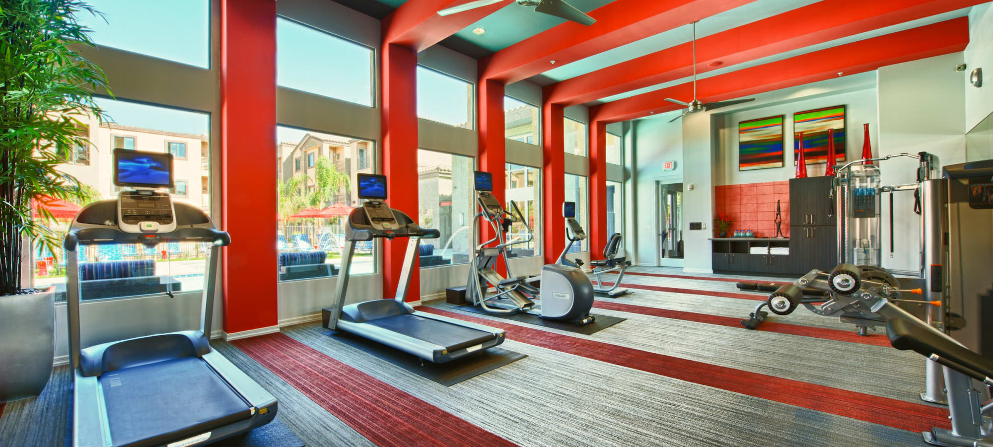 Exercise equipment in the gym at Avenue 25 Apartments in Phoenix, Arizona