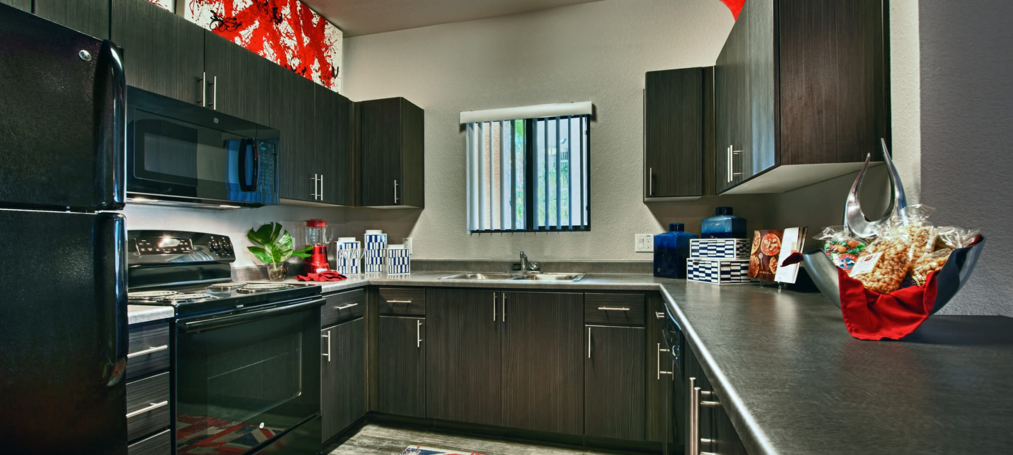 Kitchen with stainless-steel appliances at Avenue 25 Apartments in Phoenix, Arizona