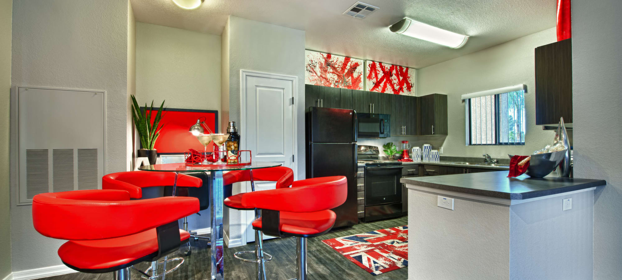An apartment dining room next to the kitchen at Avenue 25 Apartments in Phoenix, Arizona