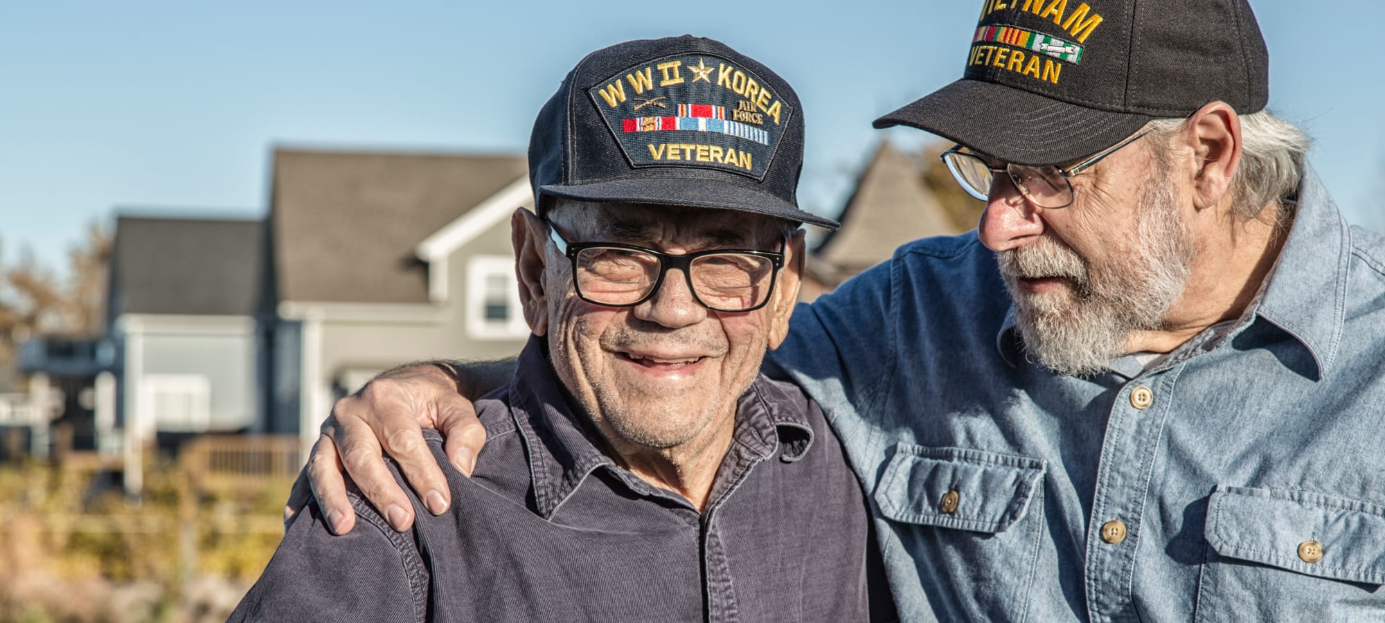 Two veterans embracing, Korean War hat