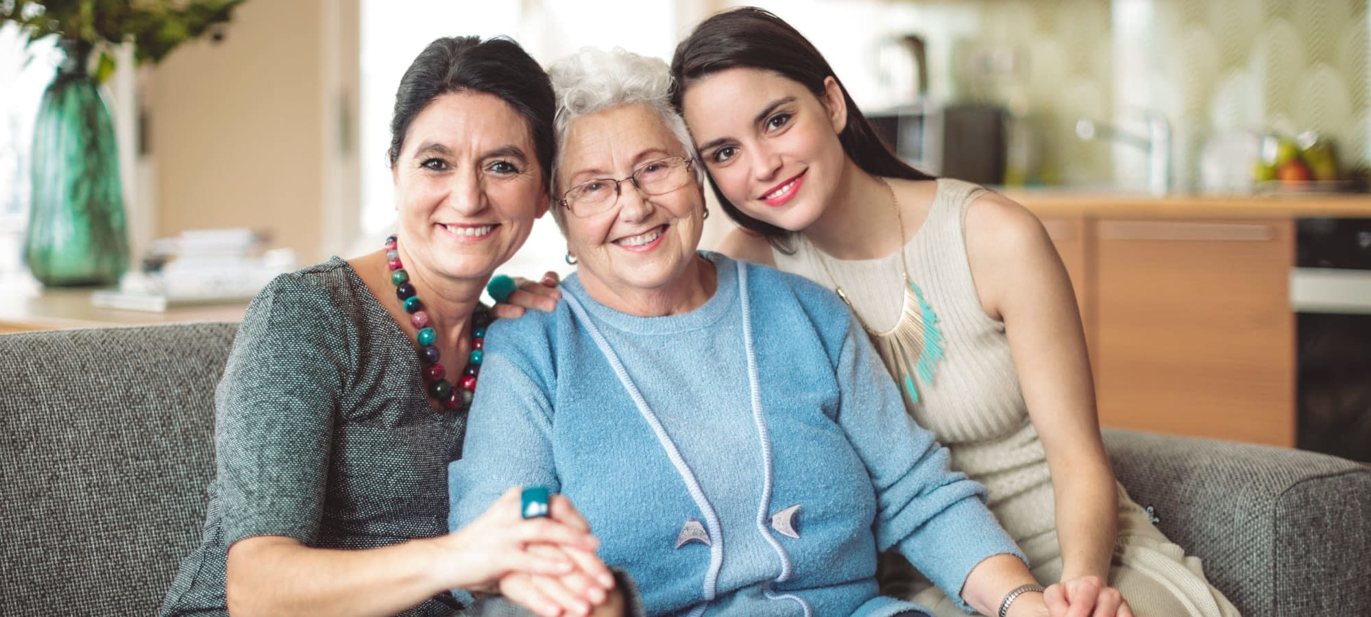 Three generations of women on a couch