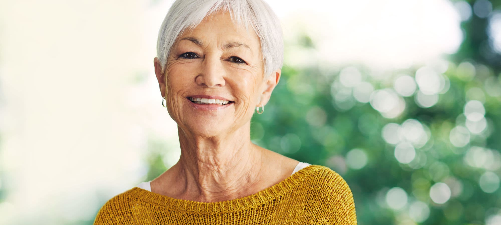 Elderly woman smiling wearing yellow short