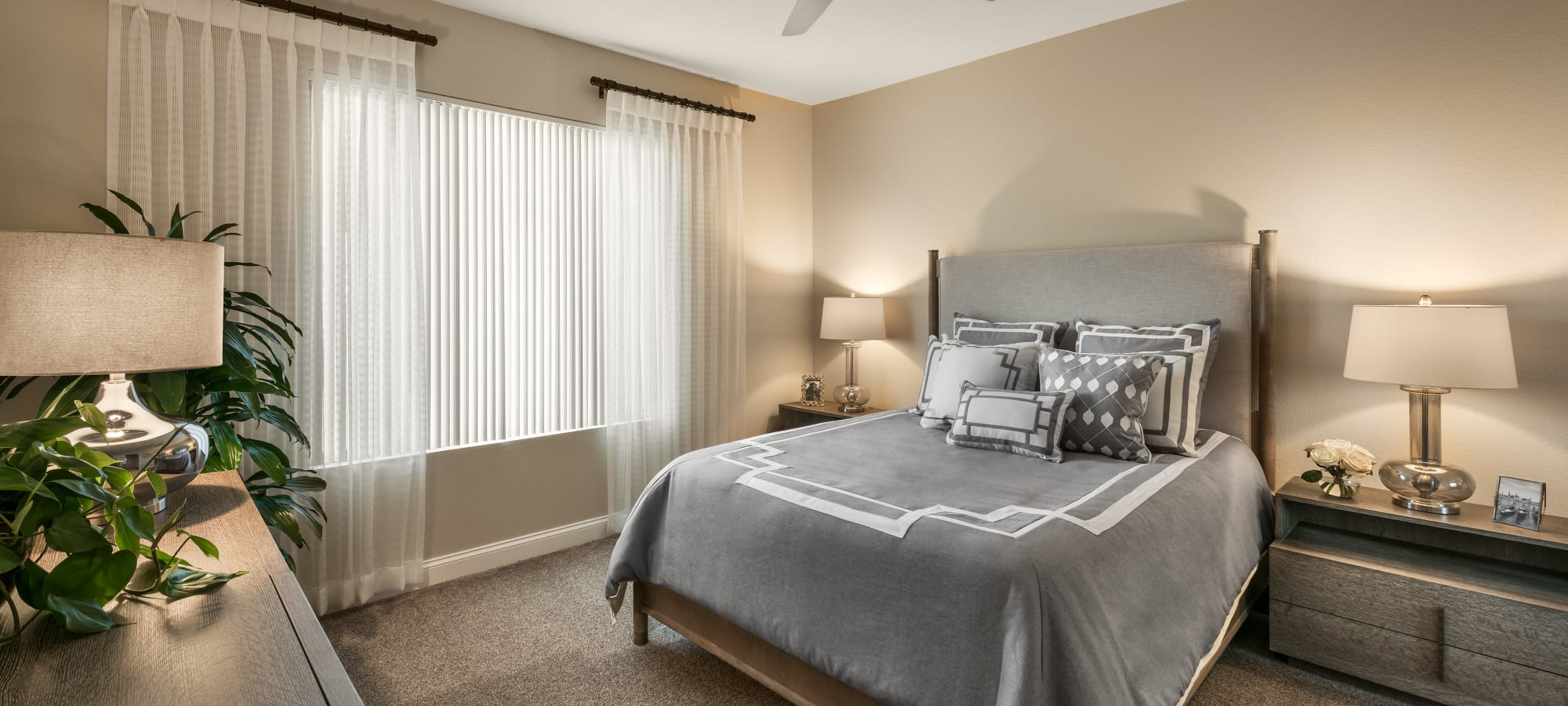 Well-decorated guest bedroom in model home at San Villante in Mesa, Arizona