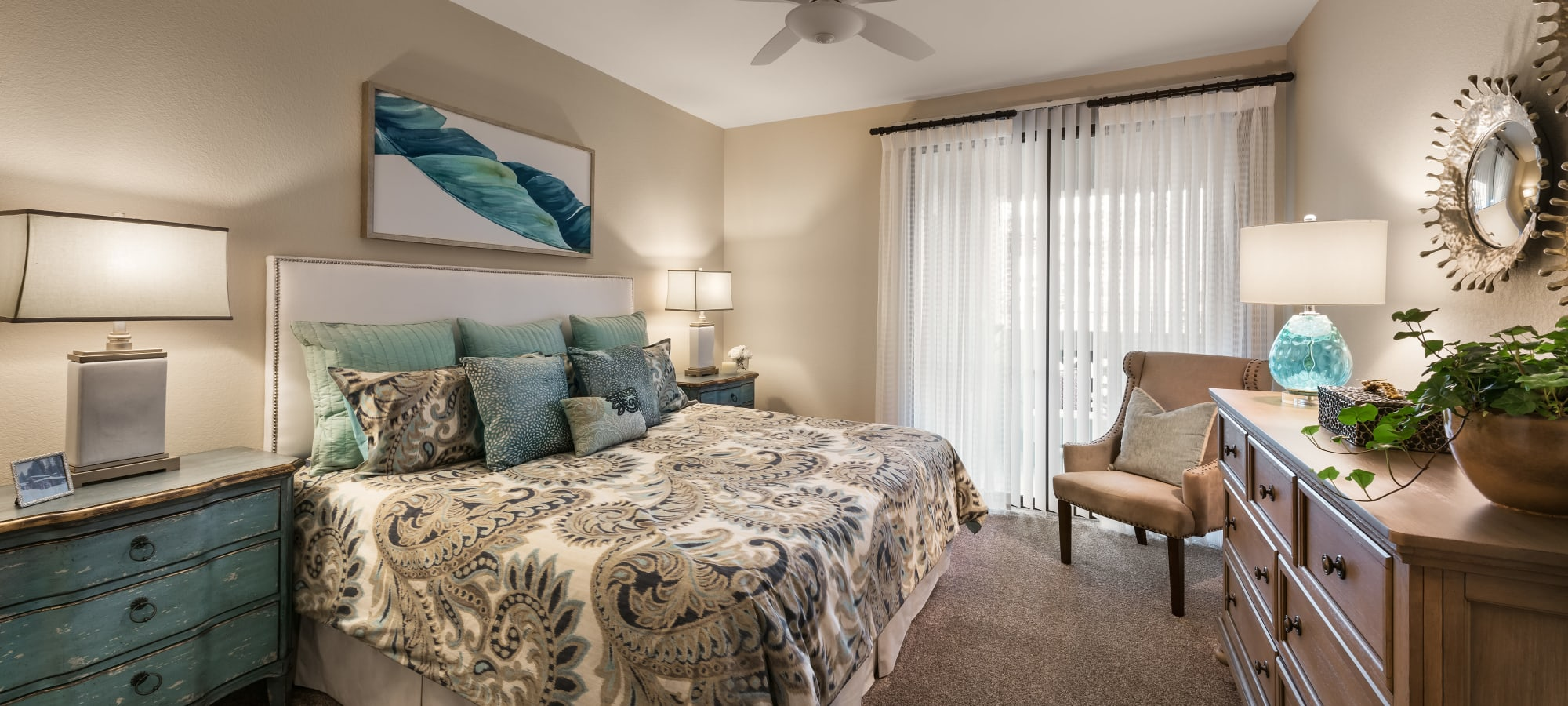 Master bedroom with plush carpet in model home at San Villante in Mesa, Arizona
