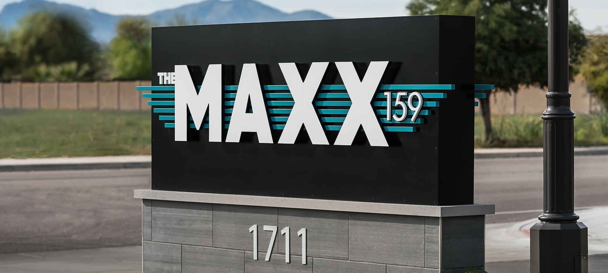 Entrance sign at The Maxx 159 in Goodyear, Arizona