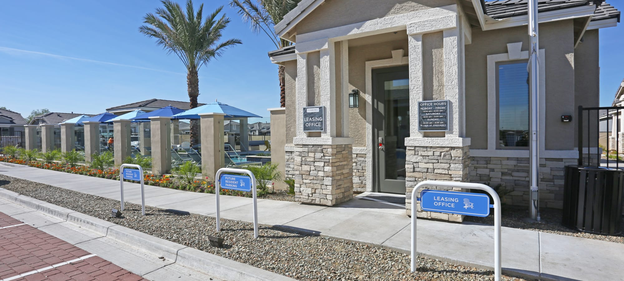 Future resident parking outside the leasing office at Christopher Todd Communities On Mountain View in Surprise, Arizona