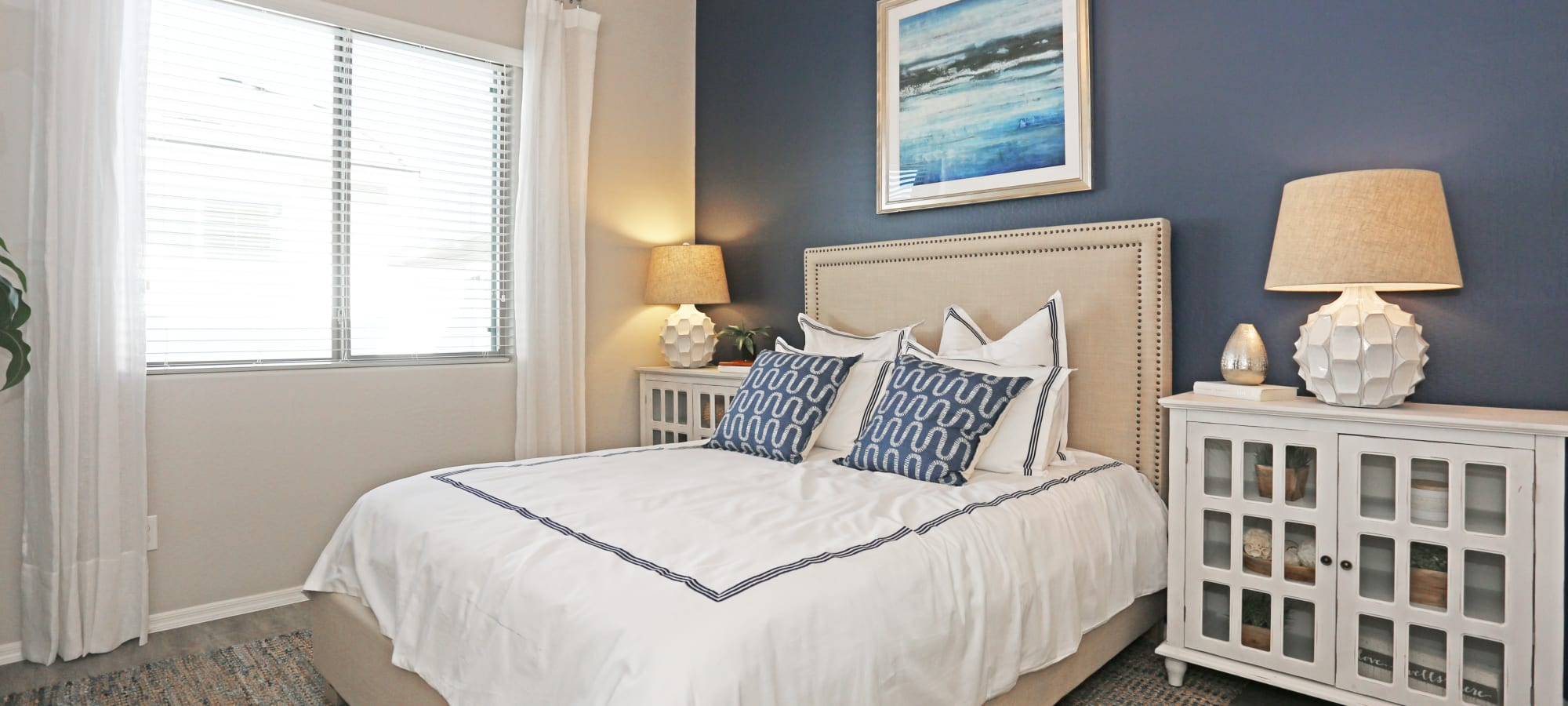 Plenty of natural light in bedroom of model home at Christopher Todd Communities On Mountain View in Surprise, Arizona