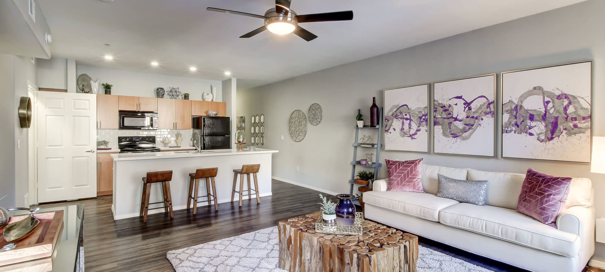 An apartment living room and kitchen at Spectra on 7th South in Phoenix, Arizona
