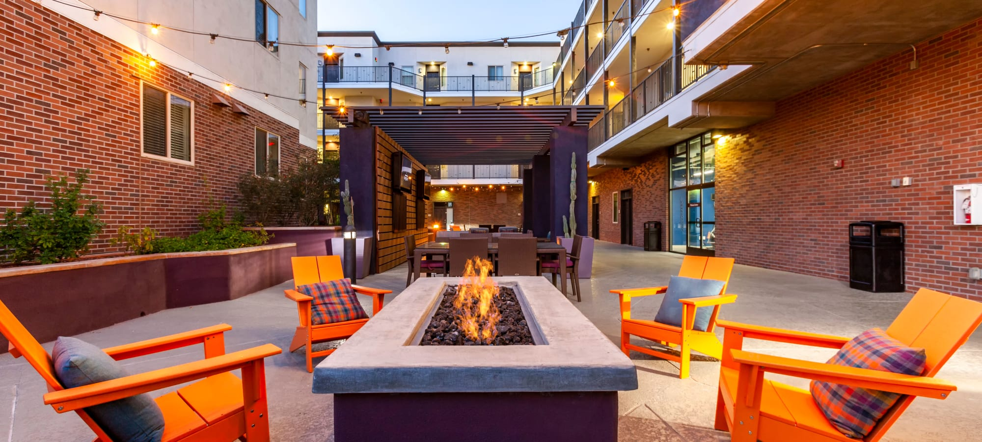 Outdoor seating with orange chairs at The Fleetwood in Tempe, Arizona