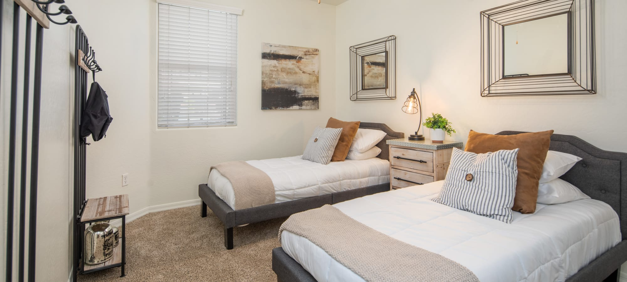 Two beds in a bedroom at The Fleetwood in Tempe, Arizona