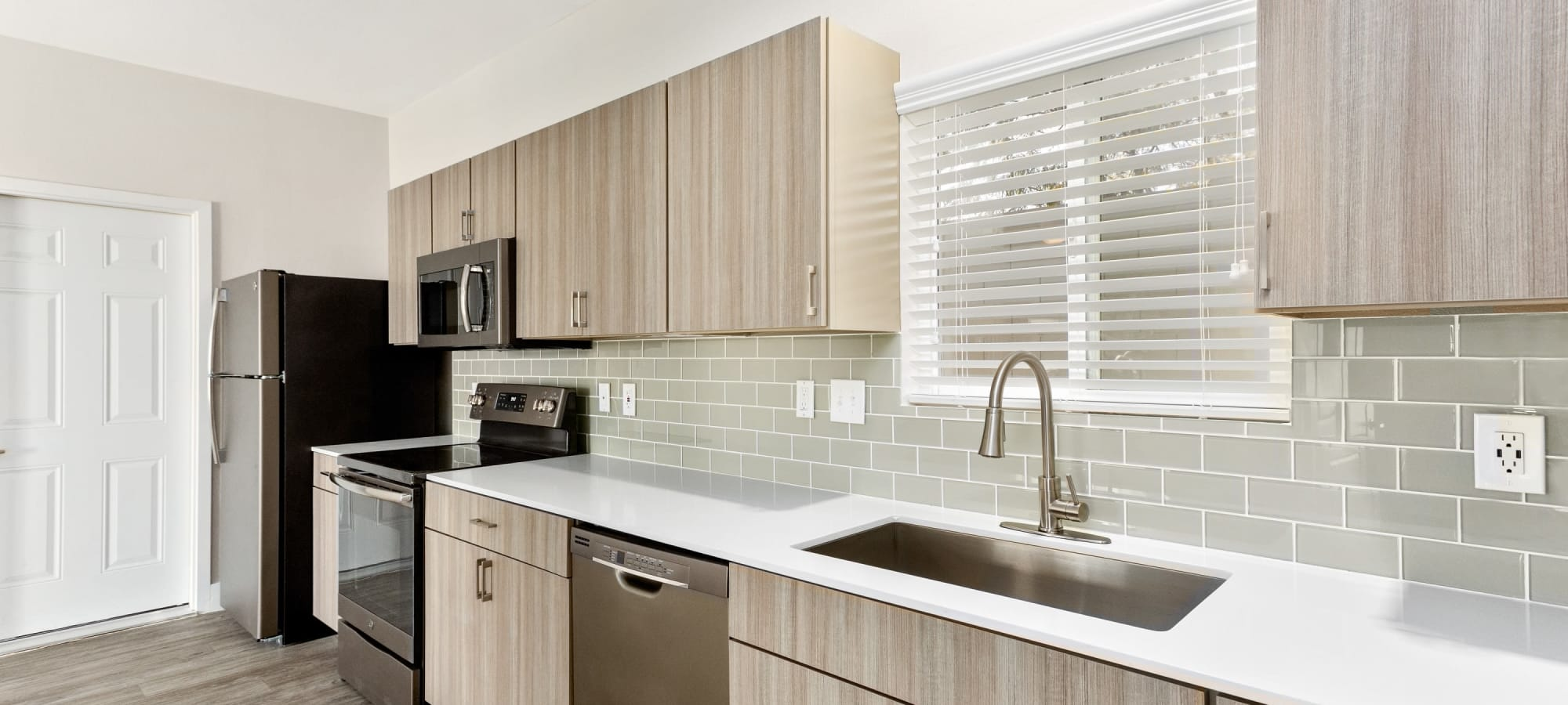 Kitchen with stainless-steel appliances at The Sterling in Gilbert, Arizona