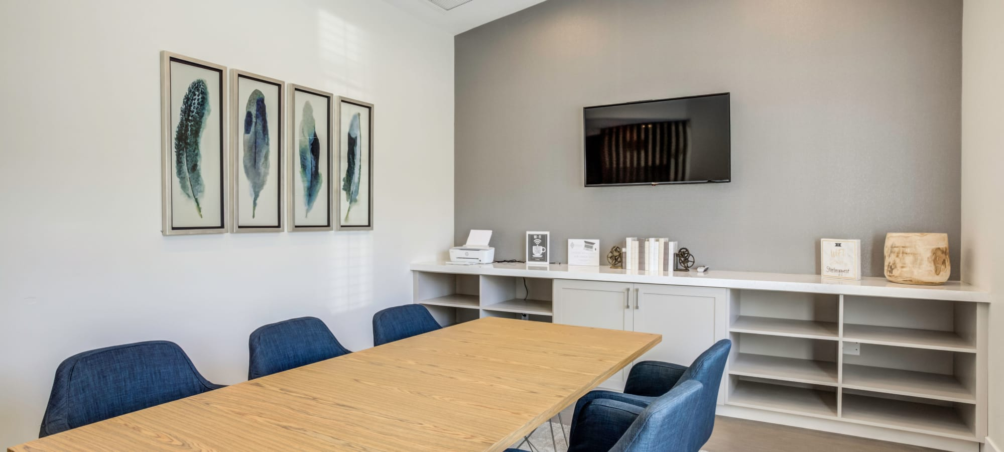 Business center with blue chairs at The Sterling in Gilbert, Arizona
