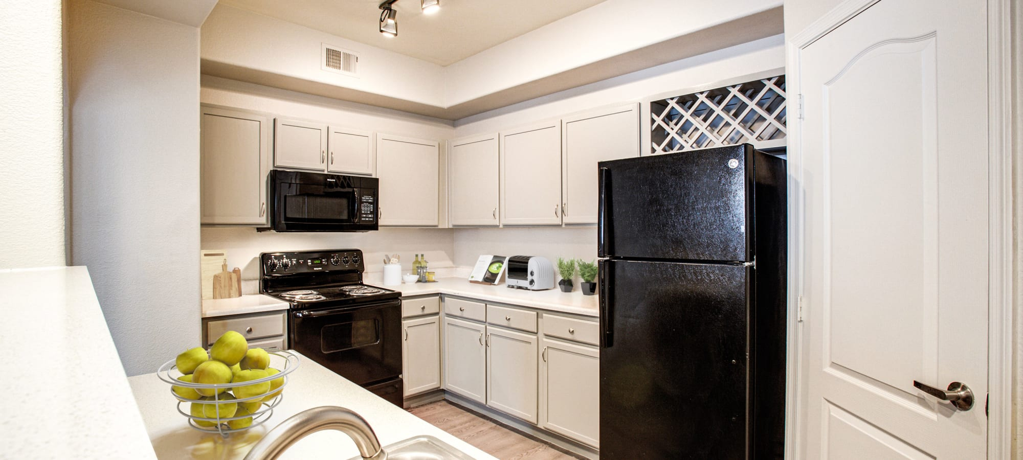 Kitchen with green accents at The Sterling in Gilbert, Arizona