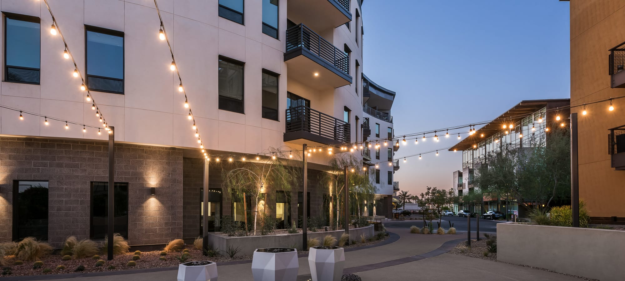 Outdoor patio area with string lights at Gramercy Scottsdale in Scottsdale, Arizona