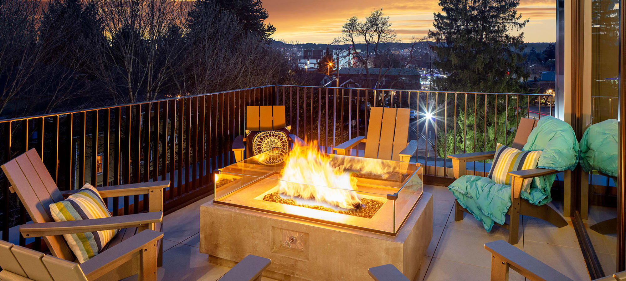 Patio seating with a lit fire pit at Sandy Fifty One in Portland, Oregon