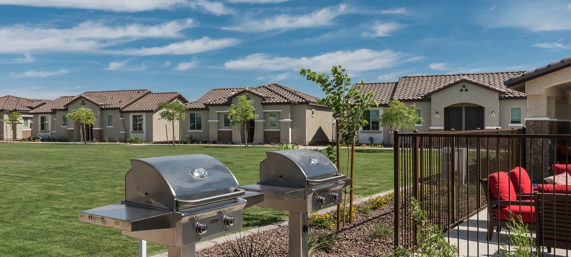Outdoor grilling area at TerraLane at Canyon Trails in Goodyear, Arizona