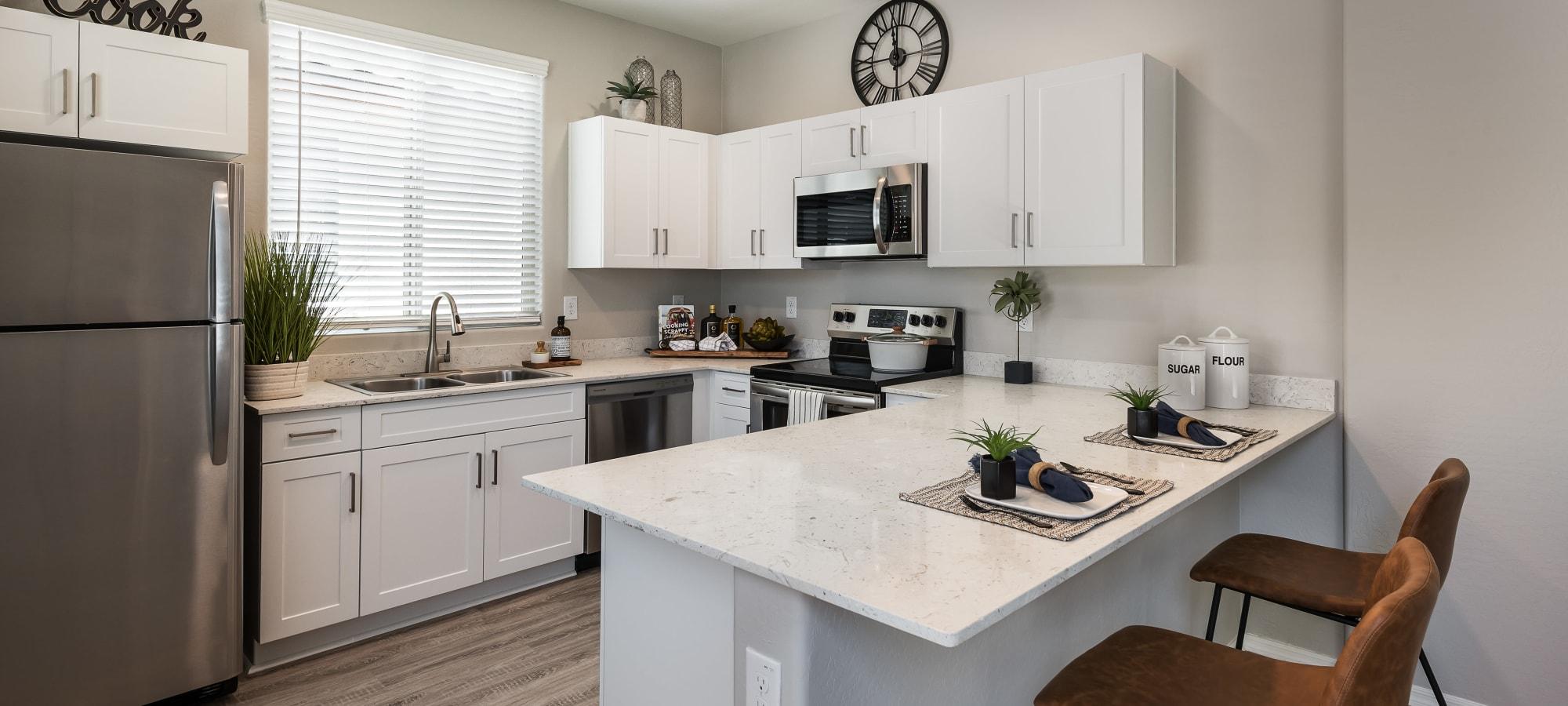 Spacious interior and kitchen at TerraLane at Canyon Trails in Goodyear, Arizona