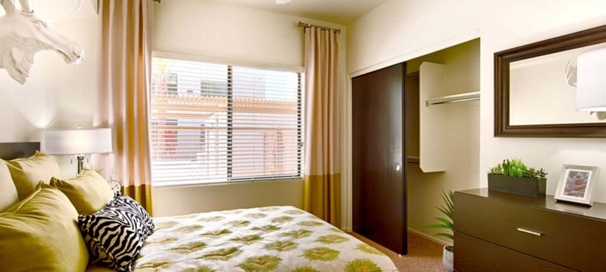 Bedroom with walk-in closets in model home at Cactus Forty-2 in Phoenix, Arizona
