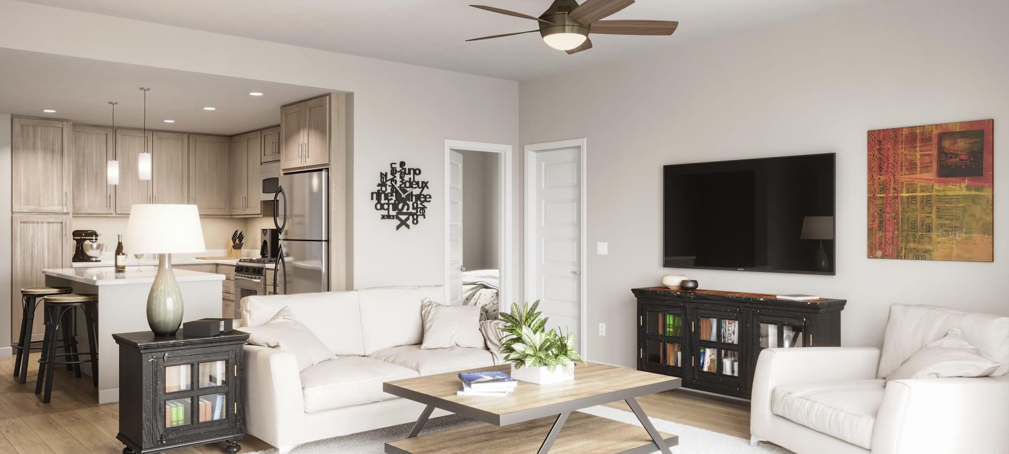 In unit view of kitchen & living room at Estia Surprise Farms in Surprise, Arizona
