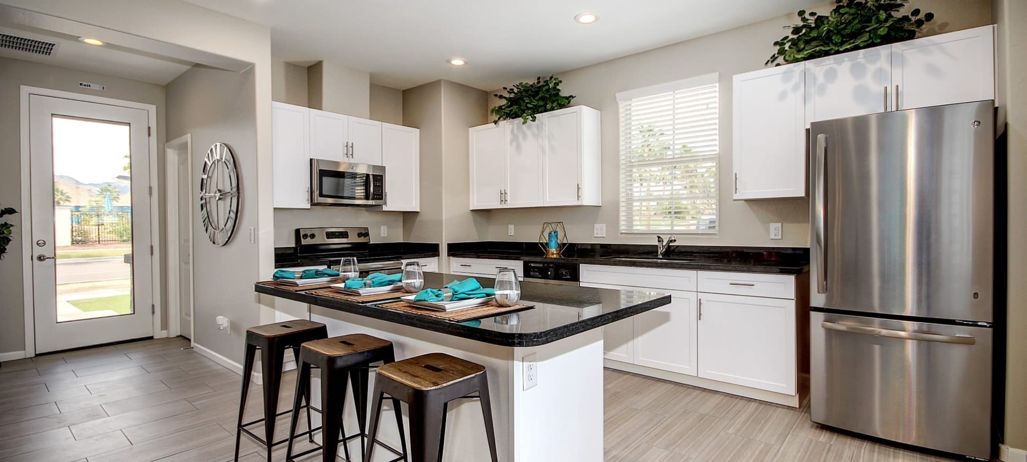 Modern kitchen and dining area at BB Living at Val Vista in Gilbert, Arizona