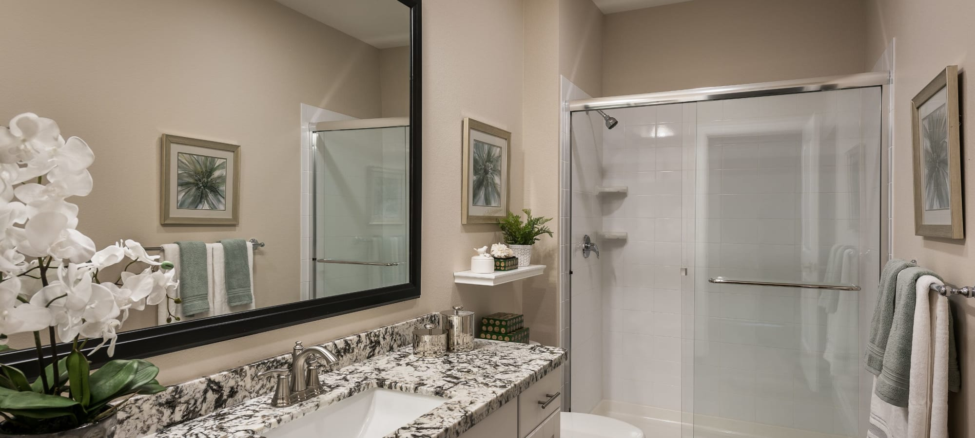 Bathroom with a glass door shower at San Artes in Scottsdale, Arizona