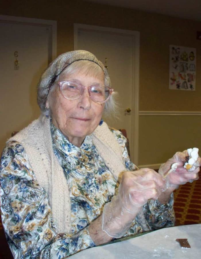 A different resident making smores at Heritage Hill Senior Community in Weatherly, Pennsylvania