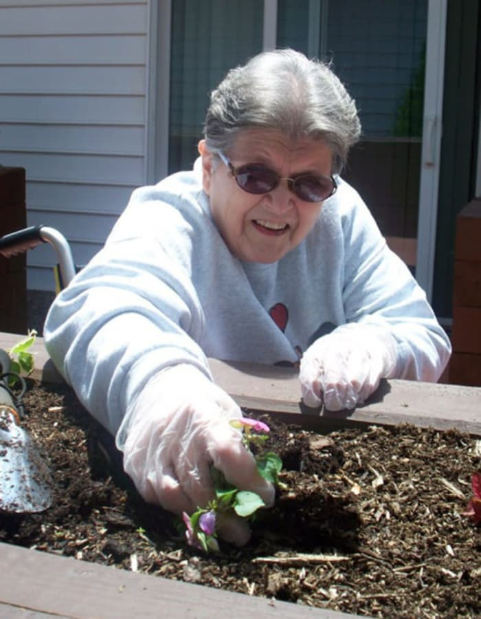 Resident seeding a small plant at Heritage Hill Senior Community in Weatherly, Pennsylvania