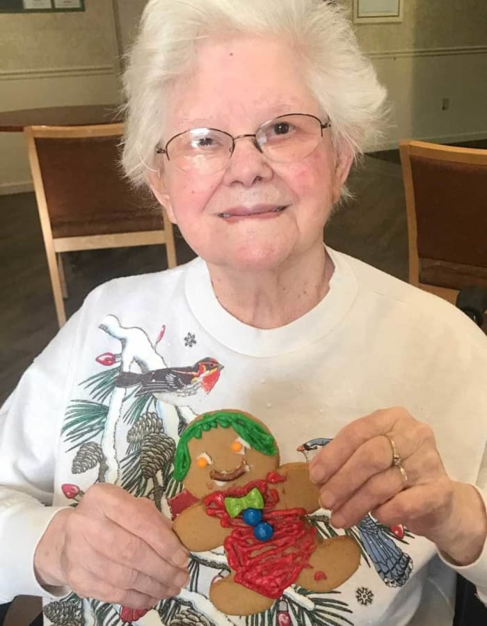 Resident presenting the gingerbread man they made at Heritage Hill Senior Community in Weatherly, Pennsylvania