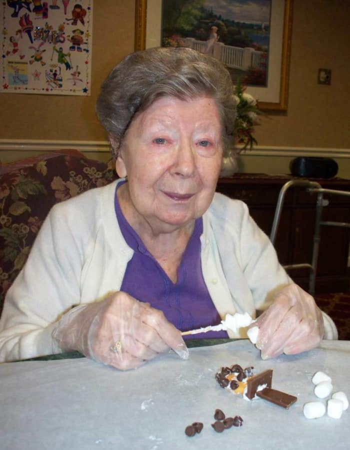 Resident making smores at Heritage Hill Senior Community in Weatherly, Pennsylvania