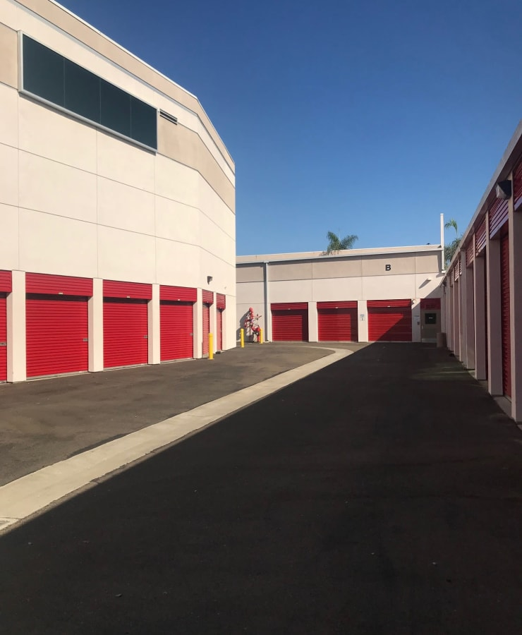 Outdoor units with red doors at StorQuest Self Storage in Carlsbad, California