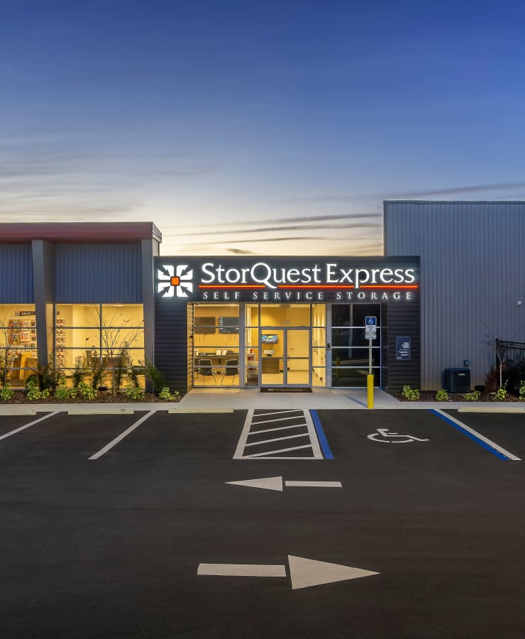 Facade and surrounding landscaping at StorQuest Express - Self Service Storage in Deltona, Florida