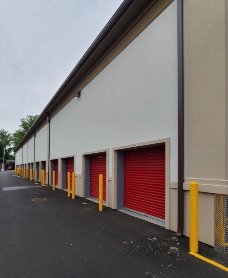 Outdoor storage units with red doors at StorQuest Self Storage in Thornwood, New York